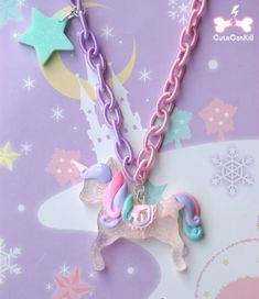 Adorable unicorn necklace by Cute Can Kill. <3
