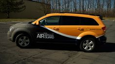 Vehicle wrap on a Dodge Journey for Ohio Air National Guard.