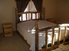 King pine log bed and frame,       sold for: $650