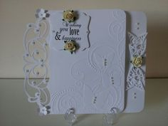 Wedding Day card. Die used: Tonic Studio's Verso Header - Ornate Elegance and Darice butterfly embossing folder.