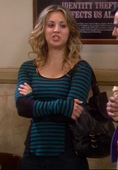 Penny's blue striped longsleeve top and black handbag on The Big Bang Theory.  Outfit details: http://wornontv.net/3704/