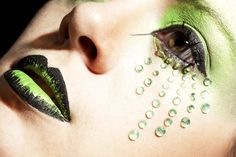 Apple green and black make-up with rays of green jewels.
