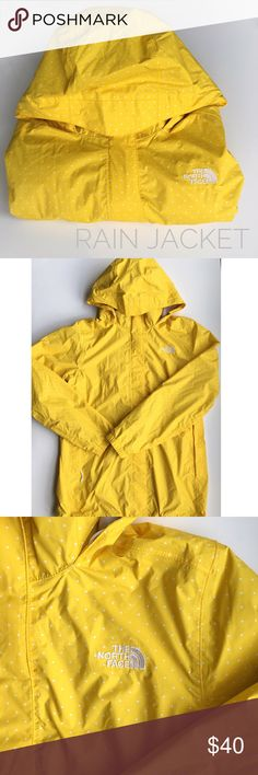 North Face Yellow and White Polka Dot Rain Jacket Yellow and white polka dot rain jacket. It's in great condition except for a small ink mark in one of the shoulders (my son did it right when I was getting ready to snap the pic 😭). North Face Jackets & Coats