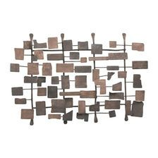 Make your living room look more dynamic with artwork. This Metal Wall Sculpture is the ONLY piece you need on the entire wall! #Design #Accessories #DailyDesign