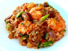 Southern American cuisine is usually hearty and full of soul. Jambalaya is a favorite which combines French and Spanish influences to create a tangy and meaty rice dish which incorporates the local… Local Seafood, Jambalaya, Boneless Chicken, Rice Dishes, Fried Rice, Real Food Recipes, Spanish, Southern, Healthy Eating