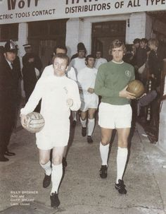 Circa 1970. Billy Bremner leads his out Leeds United team.