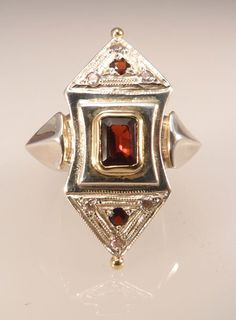 Starburst ring.  Silver, gold and garnet.
