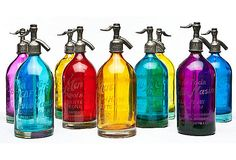Etos Vintage Seltzer Bottles....... Would be stunning in a window
