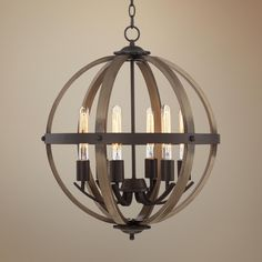 Rustic enough to please a norse god while remaining perfect for the kimpton 6 light 21 wide dark bronze and wood orb chandelier aloadofball Image collections