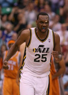 Utah's Al Jefferson growls as he heads back up court after makning a basket during second half action in the Jazz versus Suns basketball game at EnergySolutions Arena in Salt Lake City, Utah Tuesday April 24, 2012. (Steve Griffin/The Salt Lake Tribune)