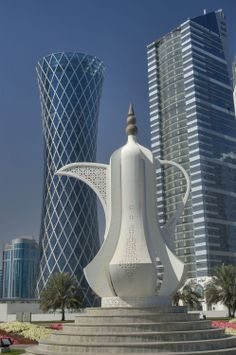 Showing Photo Giant teapot sculpture (dallah, or coffee pot monument) and West Bay towers, view from Corniche. Unique Buildings, Interesting Buildings, Amazing Buildings, Future Buildings, Plans Architecture, Futuristic Architecture, Beautiful Architecture, Architecture Details, Architectural Engineering