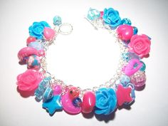 Hot Pink and Blue Rose Cabochon Charm Bracelet With Acrylic Charms and Beads £10.00