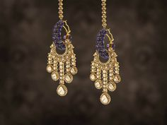These dangling earrings, with the blues of tanzanite and graceful polkis, remind us of none other than the 'Adaa' of Umrao Jaan - the dancer, poetess and a beautiful woman who has inspired us to design the collection 'Adaa'