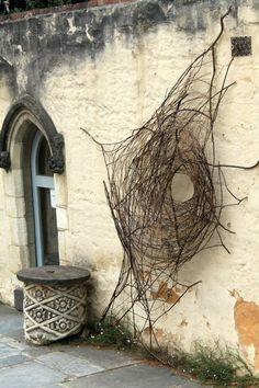 Sculptor Wona Bae at Montsalvat tree limbs nest web circle nature outdoor sculpture