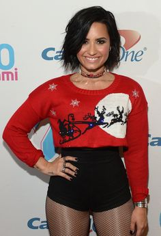 Demi Lovato rocked a festive, cropped holiday sweater and tiny booty shorts while performing at the iHeart Radio Jingle Ball in Sunrise, Fla., on Friday, Dec. 18 — see the impressive photos