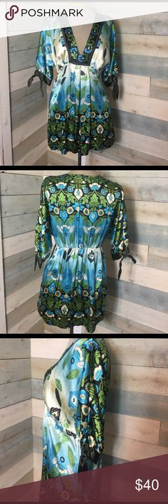 Hale Bob Silk Green Blue Floral Blouse Boho Tunic Silk and Spandex blend, feels soft and has some stretch. Dry Clean only. Medium. Very tiny flaw on bottom front upon close examination, but still looks and feels new overall. Non smoking home. Hale Bob Tops Tunics