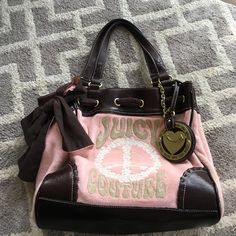 Juicy Couture shoulder bag Large juicy purse in awesome condition!! Comes with embellishments on outside as well as a spacious inside with pocket for phone and mini mirror attached! Juicy Couture Bags Shoulder Bags