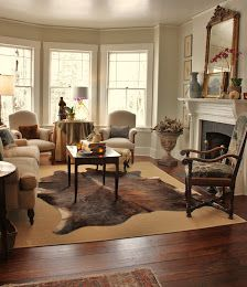 Love the pair of antique French chairs and the purposeful lack of window treatments.