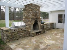 Outdoor Fireplace Kits for the DIYer , Wood-burning Fireplace/oven in gorgeous outdoor kitchen. -The KormendyTrott Team - Century 21 Miller Real Estate Oakville. Backyard Kitchen, Outdoor Kitchen Design, Backyard Patio, Backyard Barbeque, Modern Backyard, Kitchen Rustic, Big Green Egg Outdoor Kitchen, Kitchen Small, Outdoor Rooms