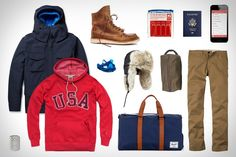 Garb: Olympic Cold Homage USA Hoodie ($65). Aspesi Thermoregulating Double-Layered Field Jacket ($1,395). Herschel Novel Duffle Bag ($80). Uniqlo Regular Fit Chino Trousers ($49). Canada Goose Aviator Trapper Hat ($225). Ball and Buck Waxed Canvas Dopp Kit ($68). SpeakEasy Russian Translator App ($4). F1 4 Pack Travel Bottle Set ($12). Coloud Earbud Headphones ($25). Oliberte Tompa Boots ($175). Zippo Hand Warmer ($13).