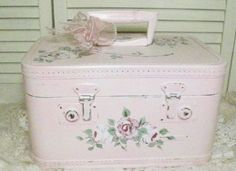 repurposed vintage train case/make-up travel case.  I love this look.