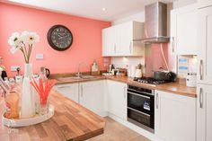 Pink and white country style kitchen with wood style worktops, new home, 4 bedroom townhouse.
