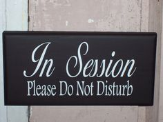 Whimsical Shabby Cottage Wood Vinyl Sign With Ribbon - In Session Please Do Not Disturb. $16.99, via Etsy.