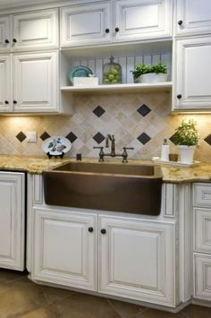 distressed white cabinets and copper sink