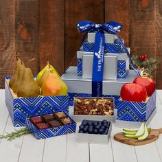Our 2017 Holiday Gift Tower is a gorgeous silver and blue box set filled with delicious fruits and gourmet treats. Surprise a loved one with this delectable gift.