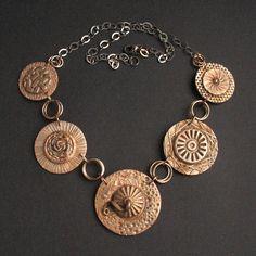 Anna Fidecka's bronze clay necklace.