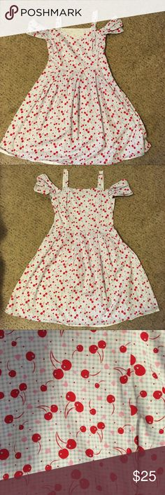 Blue gingham cherry heart print pinup retro dress Handmade by me (I'm a seamstress, you can trust that this was made well)! Pinup retro inspired! Light blue and white gingham print cotton fabric with pink hearts and red cherries all over. So cute! Completely lined in white cotton. Sweetheart neckline with thin straps, straight across back, off the shoulder puffs/sleeves for extra girliness! Full pleated skirt ready for a petticoat. Side zipper closure. Perfect condition, only worn twice…
