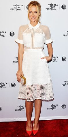 Anna Camp was a vision in white at the Tribeca Film Festival premiere of Goodbye To All That in a sheer eyelet Self-Portrait dress, injecting some glam with a white-pearl and gold-confetti Edie Parker box clutch.