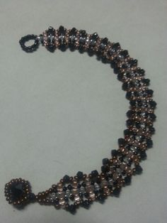 Peach and black bracelet