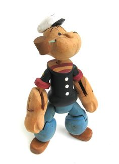 Wooden Popeye doll - this would be awesome on Elliott's shelf.