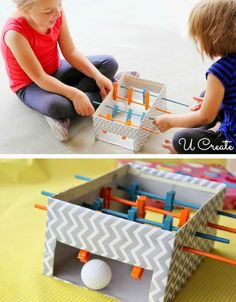 Decorated box, with ping pong ball, wooden dowel and clothes pins! What a fun toy to make!