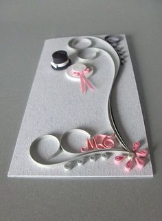 Quilled wedding card (groom and bride hats and initials)great wedding card or can be adapted to any occasion. Must learn quilling!I really need to learn quilling as I& seen so many pretty cards using that techniqueWedding Invitations and Cards / Pozi Paper Quilling Cards, Paper Quilling Patterns, Quilled Paper Art, Quilling Paper Craft, Quilling Flowers, Paper Crafts, Quilling Birthday Cards, Diy Flowers, Wedding Anniversary Cards