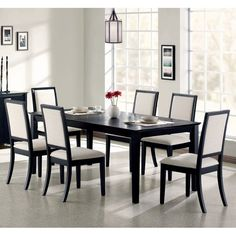 Enhance your dining room with the modern simplicity of this seven piece dining set. The table features clean, crisp lines and square legs bathed in deep distressed black finish.The creme chenille seats and seat backs of the side chairs not only provide comfort, but compliment the deep distressed black finish. This stunning dining table and chair group will create flawless dining experience!