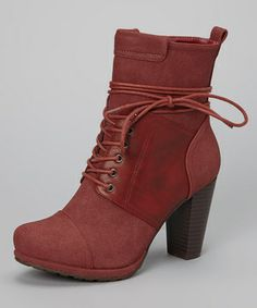If the weather doesn't allow for stilettos, try this sky-high boot as a substitute. A sassy silhouette topped off with a lace-up front that wraps around the ankle, these shoes were meant for showing off.