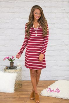 This sweet burgundy and oatmeal striped dress is such a classic fall look! The soft material is simply heavenly - you'll love wearing it all day long! It also features a scoopneck, long sleeves, and a flared look for a classic outfit!