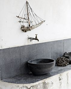 lovely rustic bathroom with handcrafted basin + tiles by made a mano.
