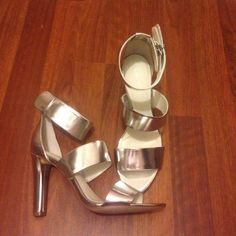 Silver Calvin Klein strappy heels Never been worn in great condition. Has slight scratches on backdrop storage but not too noticeable Calvin Klein Shoes Heels