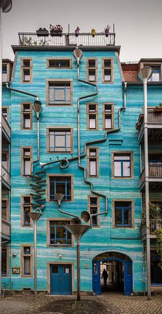 The Funnel Wall at the Kunsthof-Passage in Neustadt, Germany. It's a Rube Goldberg inspired wall that creates music when it rains, due to the mousetrap drain and gutter system with various sized metal cones!