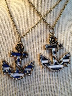 """Anchor pendant on 13"""" chain.  Comes in black and white or blue and white."""