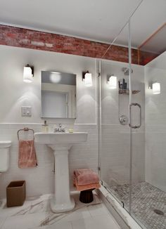 exposed brick and subway tile bathroom