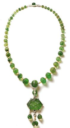 Cartier created some of the most famous emerald jewelry, mostly in the Art Deco style, for the Indian Royalty during the 1920's.  This Sautoir (1925) has fifty carved emerald beads weighing an estimated 517 carats, with platinum/diamonds and natural pearls.