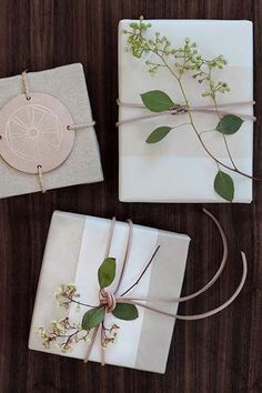 Christmas gift wrapping with neutral paper with greenery details