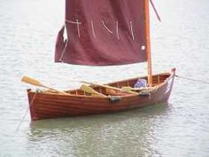 Small open sail-oar boat