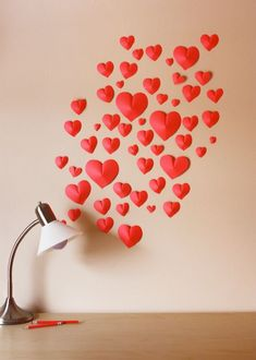 DIY 3D home Accessories- If you're trying to create a romantic mood but you don't want to spend too much time or resources doing that, this would be a very nice project. Just take a piece of red paper and trace heart shapes on it. Cut out the hearts and then make a crease where the center line is. After that you can just put them on the wall.{foun on howaboutorange}.