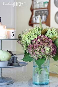 Finding Fall Home Tours 2013~Beautiful fall arrangement for the kitchen, hydrangea in a mason jar.  Love. #findingfall