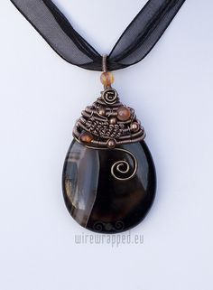 wire-wrapped briolette pendant with flourishes - ukapala on etsy